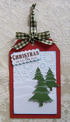 Christmas tag...with embossing, die cut trees, snowbanks...glitter and gingham...luv it!!!