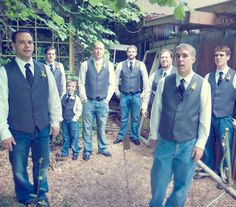 Groomsmen with gray vests and jeans.