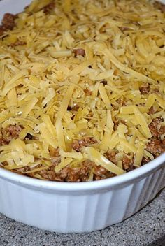 Burrito Casserole  1 lb ground beef (I use ground turkey...I dare you to try it - it's delicious in this recipe)  1/2 onion, diced  1 (1.25 oz) package taco seasoning  1 (16oz) can refried beans  2-3 cups shredded sharp cheddar cheese  6 flour tortillas  1 can cream of mushroom soup w/  4 ounces sour cream  bake 350 20-30min
