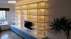 Modern bookcase with led lights - Moderne boekenkast met ledverlichting en plaats voor TV - door www.myhouse-amsterdam.nl