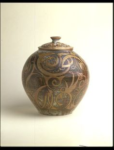Pot-pourri jar;  Date: 1968 (made);  Artist/Maker: Caiger Smith, Alan, born 1930;  Materials and Techniques: Earthenware, tin-glazed with lustre decoration