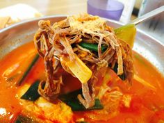 Yukgaejang, spicy Korean soup, has shredded beef, eggs, spring onions, and lots of soup. The interesting fact is Yukgaejang is served at Korean funerals.