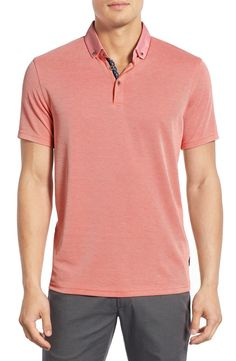 Dad will love this laid back orange button down polo that's perfect to wear for summer outings.