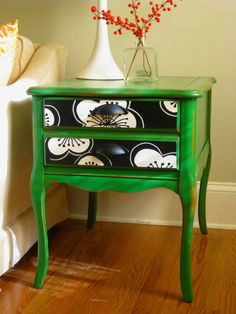 Love this bright green side table. The black and white drawers give it just enough contrast so it doesn't look too kermit the frog.