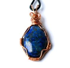 {Details}   -30mm beautiful lapis lazuli gemstone; pendant, including bail, measures 2 inches   -raw copper wire wrap, asymmetrical design, filigree backside   -soft 18 inch dark brown leather -pure copper sliding accent bead   -copper lobster clasp and swivel findings   One of my favorite pieces