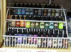 tiered spice rack that I used to store/display bottles of alcohol inks. Each shelf will hold two rows (front and back).
