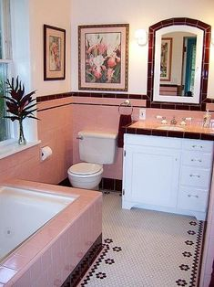 buying a house with a 50s retro pink tile bathroom.....pink white and brown.....not bad.