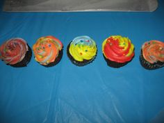 tye-dye cupcakes.  Used a 1m tip and just put different colors of  buttercream frosting into a piping bag.   I made these to go w/ the elmo birthday cake i made for my son.  i had lots of different colors left so just started putting them in the piping back was bright and fun and my boys enjoyed them!