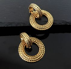Chanel earrings ,CC clip on earrings ,Authentic vintage large Chanel gold clip on earrings ,Chanel hoop earrings  ,Chanel statement earrings by NUKOBRANDS on Etsy https://www.etsy.com/listing/239182233/chanel-earrings-cc-clip-on-earrings
