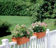 Deck railing planters add planting area to a deck, balcony or porch