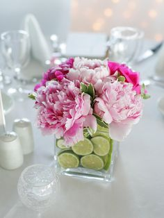 This simple arrangement of blooming perennials and lime slices adds color and fragrance to any casual spring or summer gathering.