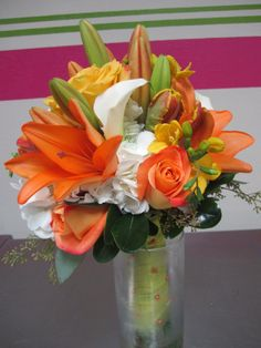 white hydrangea, orange asiatic lilies, white callas,yellow roses, orange roses, yellow freesia, parrot tulips, seeded euc