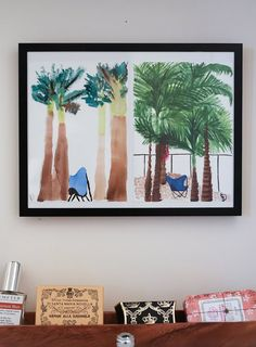 Design*Sponge: One day, Jeannine and David decided to paint the same scene and see what happened. The results are framed here. Jeannine thinks of it as a great reminder of how two people's view of the same thing can be different and neither one right or wrong.