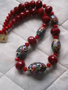 by Anne Marie | 5 antique Venetian oval Milelfiori beads that from the 1930s-1940s. They are strung with Bali vermeil (sterling silver with 22 K gold) and cherry quartz beads | BeadArt Austria Designs | SOLD