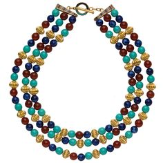 Three strings of beads in the Museum's collection, made of gold, turquoise glass, and lapis lazuli (New Kingdom, Dynasty 18, ca. 1479–1425 B.C.), came from the tomb of the three foreign wives of Thutmose III. These ancient Egyptian beads are the source for our colorful necklace. 24K gold overlay, with lapis-, turquoise-, and carnelian-colored glass. Hand-enameled toggle closure. 18''L.  The Metropolitan Museum of Art catalogue
