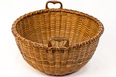 open round Nantucket Lightship Basket with pronounced carved heart shaped handles. Very unusual form, most likely used as a sewing basket.  Attributed to Charles F. Ray (1826-1901), son of Capt. Charles Ray and the father of Clinton Mitchy Ray. He was a cooper and was a crewman abourd the Crossrip Lightship c.1880-1900.