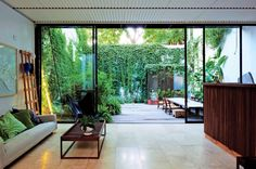 Indoor/outdoor living. Love the courtyard covered in ivy.