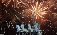 Dramatic: Fireworks explode during New Year celebrations over the Brandenburg Gate in Berlin