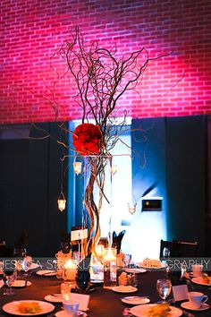 Hang tea light candles from your centerpieces to add another element of interest. Floral Design by McNamara Florist - Enflora