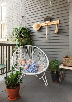 Brook on the back patio enjoying a seat in an Acapulco chair by Prunelle. Studio Apartment, Apartment Therapy, Fireclay Farmhouse Sink, Acapulco Chair, Mexican Home Decor, Old Farm Houses, Modern Farmhouse Style, Affordable Furniture, Eclectic Decor