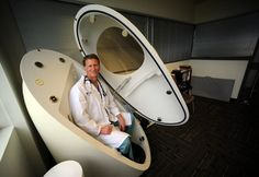 Dr. Michael J. Sehl, of the AIM Institute of Lifestyle Medicine, sits in a pod used to measure body fat in the the company office in Waterloo.  AIM's focus is healthy living and preventive medicine.