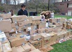 Lev Tsidilkovski and Francesca Huber were among more than 100 Rensselaer Polytechnic Institute student who were trying to build the world's largest cardboard box fort on the campus' '86 Field Saturday afternoon. (Jeff Couch/The Record)