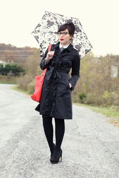 trending: dark but not drab  Rainy Day Style [[MORE]]  Just because the day is dreary doesn't mean your look needs to be.  Blogger Keiko Lynn scored this pieces at T.J.'s:  Designer trenchcoat  Brand name knee socks  Top name shirt  Top quality floral umbrella  Image credit: Keiko Lynn (High res)