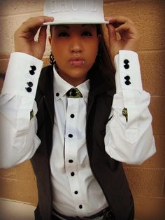 Sporting the White Button up with the Navy Buttons and Paisley Printed accent - topped off with the White HAUTE snapbax http://www.hautebutch.com/portfolio/white-button-up-with-paisley-accented-collar-flip-cuff-2/gallery/dress-shirts   #androgynous  #fashion  #lgbt