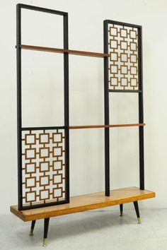 I love the airiness of this room divider.  Love the decorative metal insets.