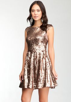 bebe | Low Back FIt & Flare Sequin Dress - Yes! Get your sparkle on!  Paired with black heels! #StyleAdvice