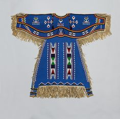 "Girl's Dress, ca.1900. Dakota (Eastern Sioux), Yanktonai or Lakota (Teton Sioux). National Museum of Natural History, Smithsonian Institution, Washington, D.C., Department of Anthropology (E362331-0) | This artwork is part of ""The Plains Indians: Artists of Earth and Sky"" on view now through May 10, 2015. #PlainsIndians #MetKids"