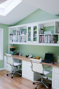We could do something like this in our long and wide hall, but that'd require getting rid of both of our desks (and I just bought mine!) and investing in new pieces...