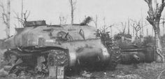 Knocked out Sherman M4A1 of the 4th British armored brigade near the Hill 112 in Normandy.