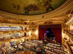 Elateneo Grand Splendid, Buenos Aires, Argentina. This gorgeous Bueno Aires store is worth visiting for the architecture alone: It was built in an old theatre with stacks of books now lining what would have been the orchestra section and the mezzanines, and tables and chairs underneath a proscenium arch on what used to be the stage. Its a dazzling, dramatic setting that makes the experience of buying book there that much cooler.