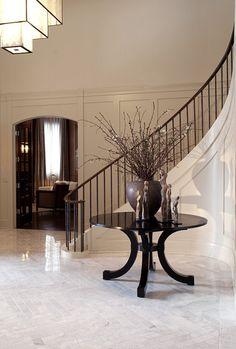 Love the modern sleek railing against traditional elements