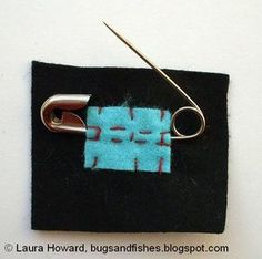 If you don't have any clasps you can use a safety pin. Use a small piece of felt sewn over the fixed bar of the pin and a crisscross pattern of stitches to sew the safety pin in place - I've used bright felt and thread here to show this clearly: