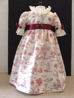 This lovely cotton dress was made especially for Felicity or Elizabeth. The fabric is an off-white background, with a toile print in red. The U