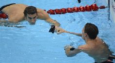 Swimming: Day 5 Finals - Swimming Slideshows | Michael Phelps (top) fist-bumps teammate Ryan Lochte following the 200m Individual Medley Semifinals.  (Photo: John David Mercer - US PRESSWIRE / Associated Press) #NBCOlympics