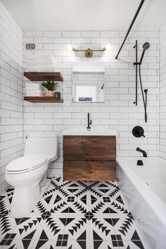 Wow! Look at this rad bathroom! That texture of the floor pattern is out of this world! And she pulls it all together with that warm toned cabinet and those matching floating shelves. Ever wondered what can make your bathroom rad? Floating shelves. Visit our site to see our collection of floating bracket sizes and before you know, you'll have a bathroom that is even radder!