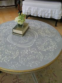 Grey and white and damask and gold leaf  all rolled into one project to create a table that had   bohemian frenchy flair. It was a table tha...
