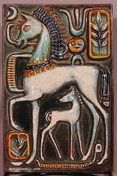 stylized Art Deco tile plaque features a horse and foal. Executed in the Egyptian Revival style by Walter Bosse  - Worked at the Karlsruhe pottery and produced fanciful animal forms. 1930′s