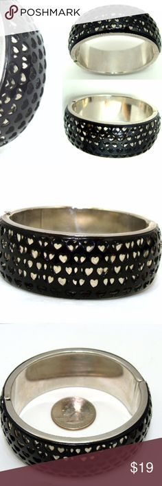 "Vintage black bracelet-gothic cut out hearts 1990s Very unique vintage metal clamper bracelet.  Black on silvertone metal ,  cut out hearts design .  Great look and interesting . It is approx 1"" wide , spring hinge clamper style .  Good condition. See my other old jewelry listed! J121 Jewelry Bracelets"