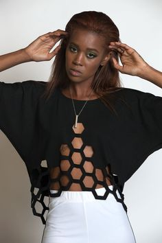 Hive Mind laser cut shirt made from thick black ponti fabric with laser cut hexagons throughout the hem and kimono sleeve detail