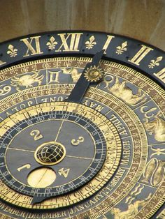 "The Astronomical Clock of Clock Court (larger) was made for Henry VIII in 1540 by Nicholas Oursian, Devisor of the King's Horologies. ""The clock shows the hour, month, day, number of days since the beginning of the year, and the phases of the moon. The sun revolves around the earth as the clock was designed before the discoveries of Galileo and Copernicus."" - Hampton Court Palace guidebook, Simon Thurley (1996, p. 44) // sircle: (12keys)"
