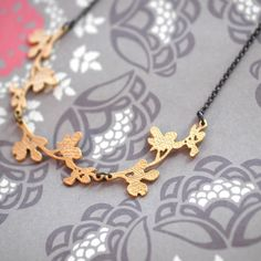 Like the leaves of an olive tree in Provence, the necklace is for natural beauties.