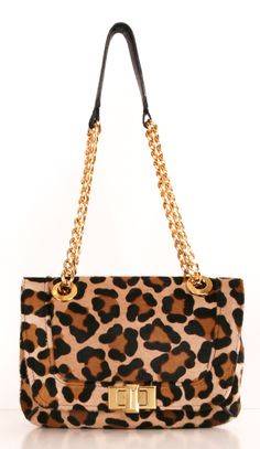 This pony hair cheetah print Lanvin handbag is bold and feminine. The bag has only been worn a few times, so it is in good condition with the exception of one of the grommets, which has come undone (see photo). There is a separate zippered compartment attached by a gold chain.