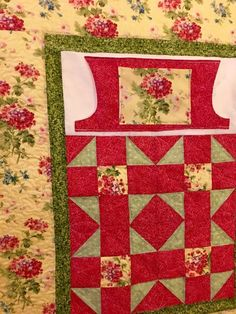 Pink Floral Lovie Lap Quilt with Pockets from http://www.HomeSewnByCarolyn.com