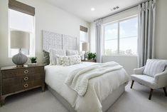 We created a cream and linen wonderland in this warm, relaxing guest room. Creating texture and depth is key in a neutral paletted design. We used a dimensional weathered headboard and plenty of texture in the pillows and throw!  Revo Plan One at Novel Park for William Lyon Homes #ChameleonOC #ChameleonDesign #ChameleonDesignOC #Bedroom #BedroomDesign #BedroomInspiration #BedroomFurniture #GuestRoom #GuestRoomDesign Bedroom Furniture, Bedroom Decor, Design Awards, Guest Room, Wonderland, Neutral, Relax, Key