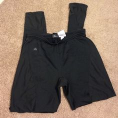Black nike dri fit leggings Black nike leggings. Dri fit Oregon series. Good condition, the logo is slightly faded and waistband is slightly stretched. Has draw strings in waistband. Nike Pants Leggings
