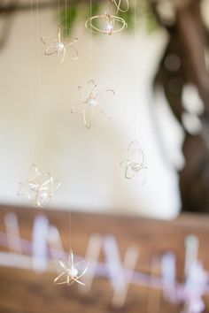 """DIY wire orbs-    These whimsical and delicate little atoms only require a couple materials and some manual dexterity. We designed them for our inspiration shoot """"The Artist & the Scientist"""" and suspended them over the table, but they're versatile little things and can be used in a number of ways!"""